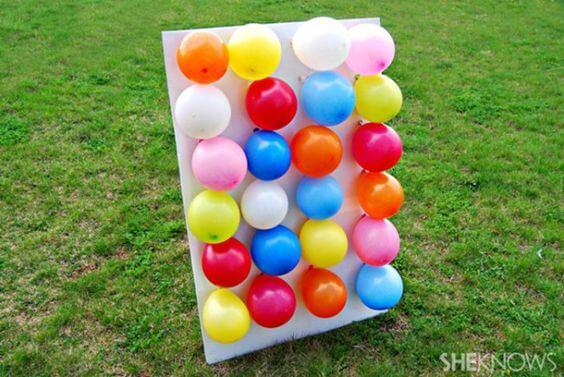 Painel de bexigas para jogo de dardos